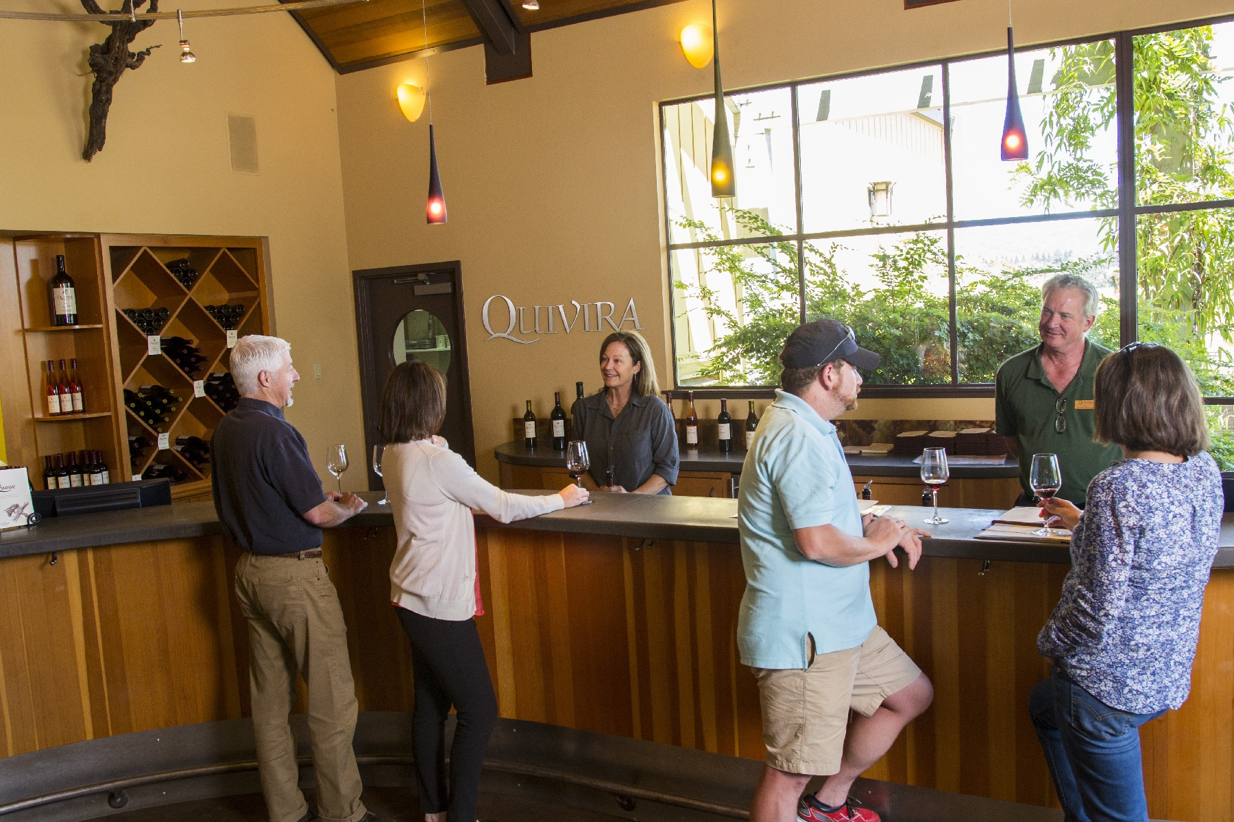 A picture of the tasting room with 6 people standing and talking